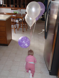 crawling around with balloons