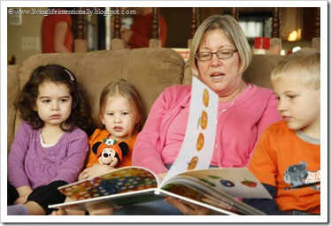 Grandma reading Hungry Caterpillar book at party