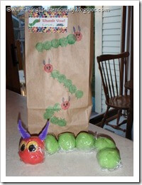 Goody bag decorated by party guests and filled with homemade kool aid playdough made to look like hungry caterpillar
