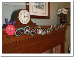 Decorations: Hungry Caterpillar with pictures of 1st year on mantel