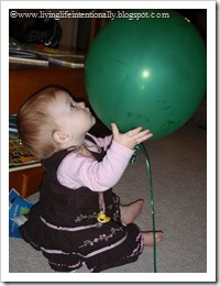 She loved playing with the balloons