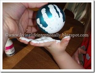 Snowman Hand Art Ball Ornament