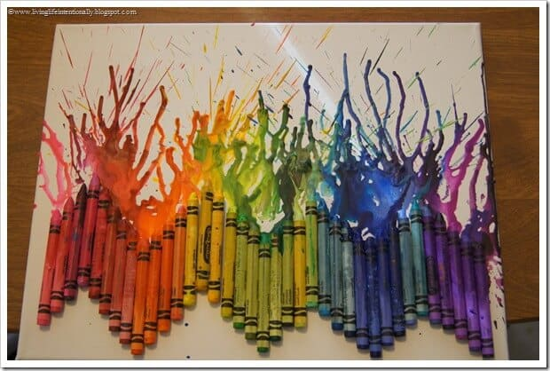 BEAUTIFUL and fun-to-make Melted Crayon Art This craft is fun for kids and adults to make and perfect to go along with the day the crayons quit or Harold's purple crayon #crayons #craft #artprojects
