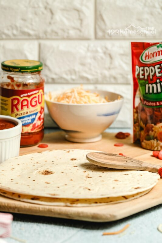 this easy lunch recipe uses flour tortilla shells, pizza sauce, pepperoni, and mozzarella cheese to make mouthwatering pizza quesadillas
