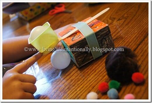 DIY Catapult Kids Activities using Pom Poms