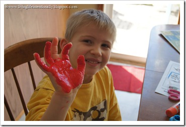 paint childs hand and fingers red except for their middle finger