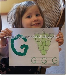 kids will have fun tracing uppercase letters with these free alphabet printables for toddlers, preschoolers, and kindergartners;pictured is letter g is for grapes