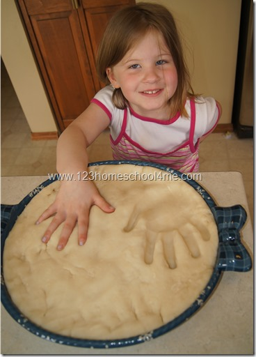 Press child hands in mold