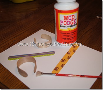 Mod Podge to decorate Craft Stick Bracelet