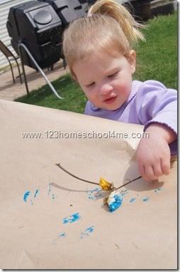 Toddler art using flowers
