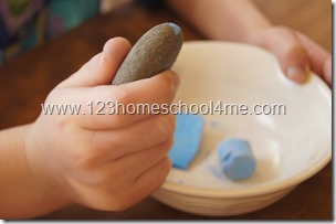 crushing chalk to make egg based tempera paint