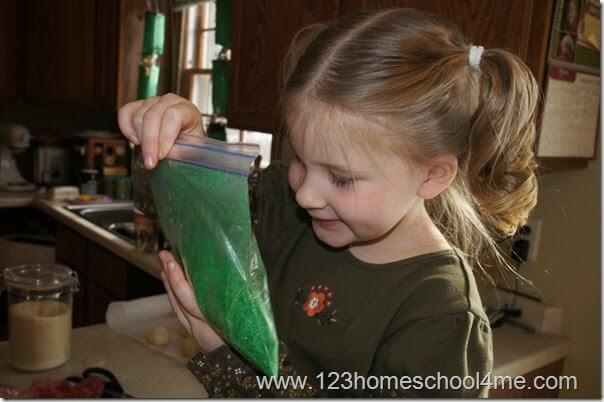 Preschooler mixing homemade sand