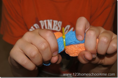 use a Rubberband or cable tie