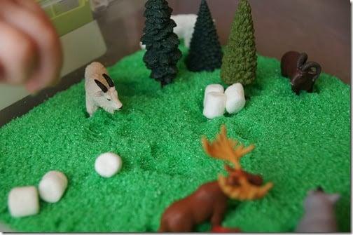 Preschool Science - forest habitat sensory bin with scented homemade sand