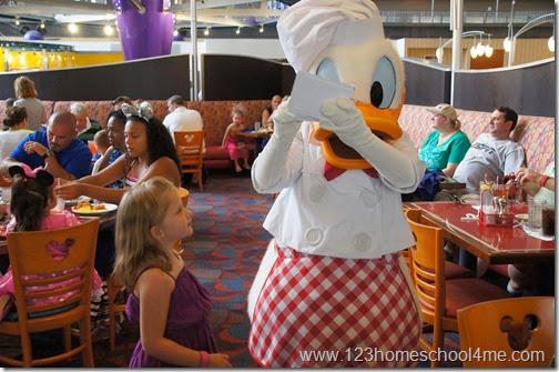 Getting an autograph from Donald Duck at Chef Mickey's at Disney World
