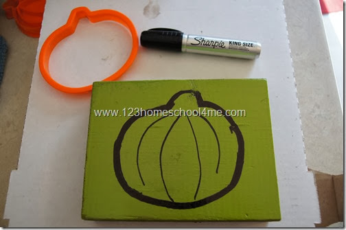 trace your pumpkin cookie cutter onto your wood using your sharpie