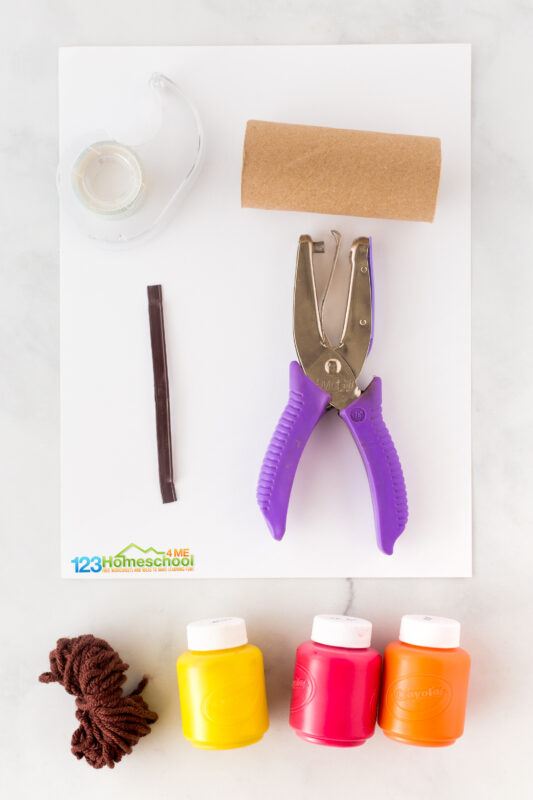 All you need for this project are a few simple supplies you probabaly already have at home:  cardstock hole punch brown yarn scissors  tape tp roll fall colored paint markers or crayons