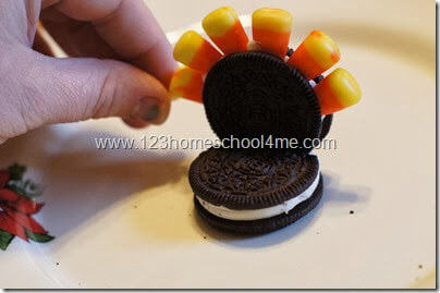 add in candy corn feathers
