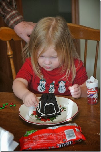 toddler decorating her gingerbread house