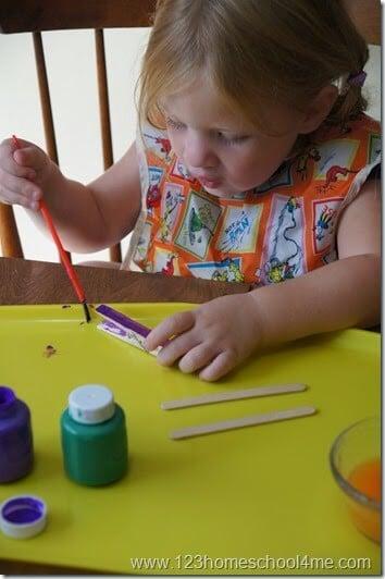 Preschooler painting her airplane