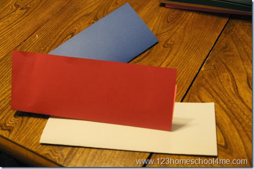 fold red, white, and blue paper in half lengthwise