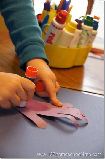 glue the cut out rainbow colored hand
