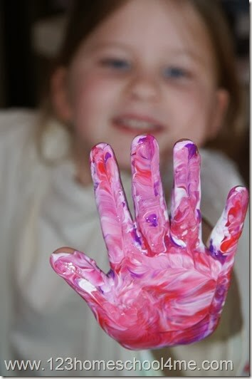 have your child squish their hand in the paint