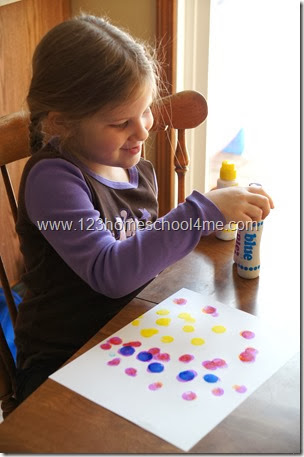fill a piece of paper with colorful bingo markers