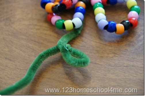add green pipe cleaner for stem and leaf
