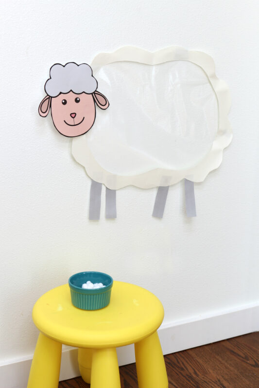 This sticky sheep activity is a fun way for young kids to work on fine motor skills and pincer grasp