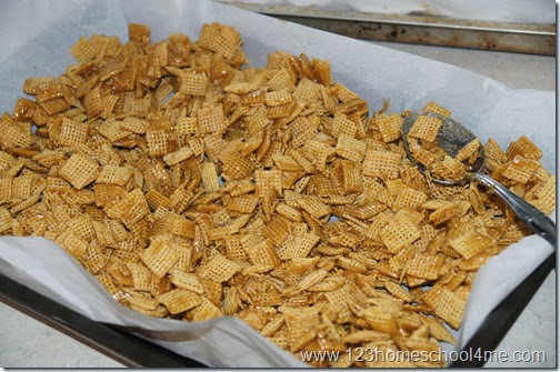 Toss cereal square with carmel snack mix