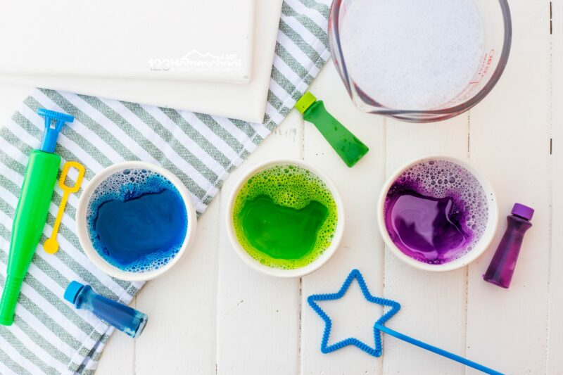 use food coloring mixed with bubble solution to make colored bubbles for your paint