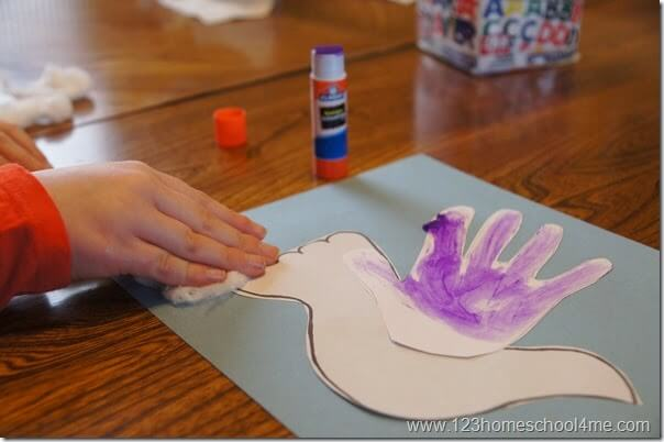 glue the hand on the dove