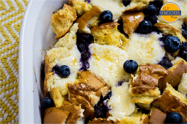 pour egg, milk, and maple syrup mixture over breakfast casserole