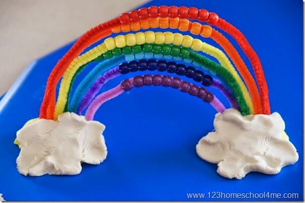 keep yoru pony bead threaded pipe cleaners in playdough to hold them up