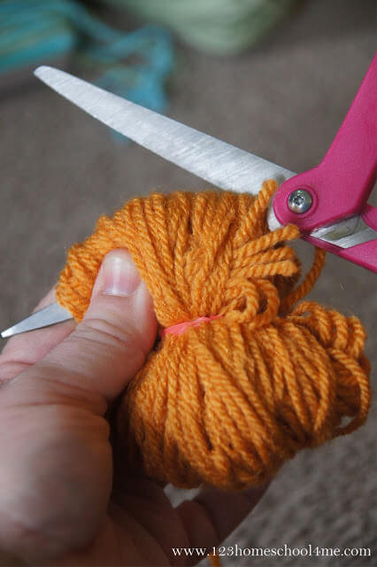 now cut the sides of the yarn balls