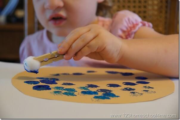 stamp blueberries in construction paper pie