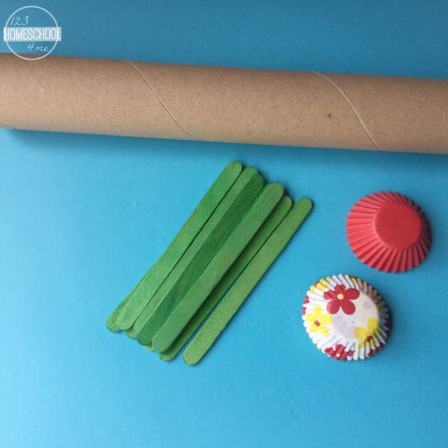 paper towel roll, cupcake liners, Popsicle stick math activity