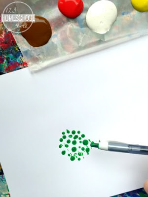 use a pen to paint circles on a paper to make pointillism art project