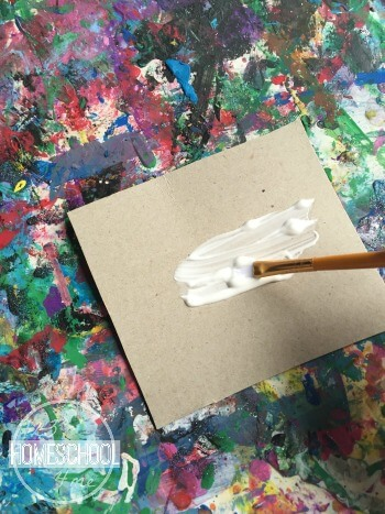 paint the cardboard piece with glue