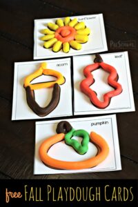 use these fall playdough mats as a template to make sunflowers, acorns, leaves, pumpkins, and more