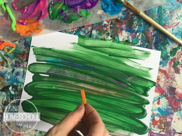 spread green tempera paint over the top