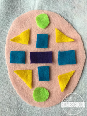 glue felt shapes to larger felt sheet for this fun winter math activity for kids