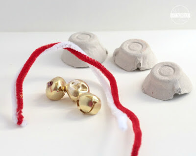 egg carton, pipe cleaners, and bell craft for kids