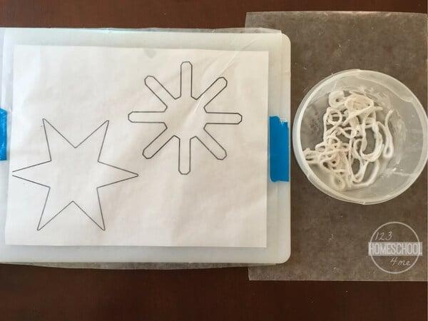 snowflake crafts using wax paper, yarn, school glue, and jewels