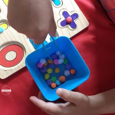 number puzzles, pom pom and tweezers