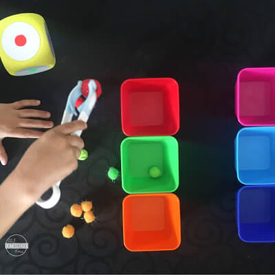 tongs and pom pom color sorting game for fine motor development