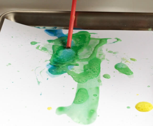 use a straw to blow on the paint
