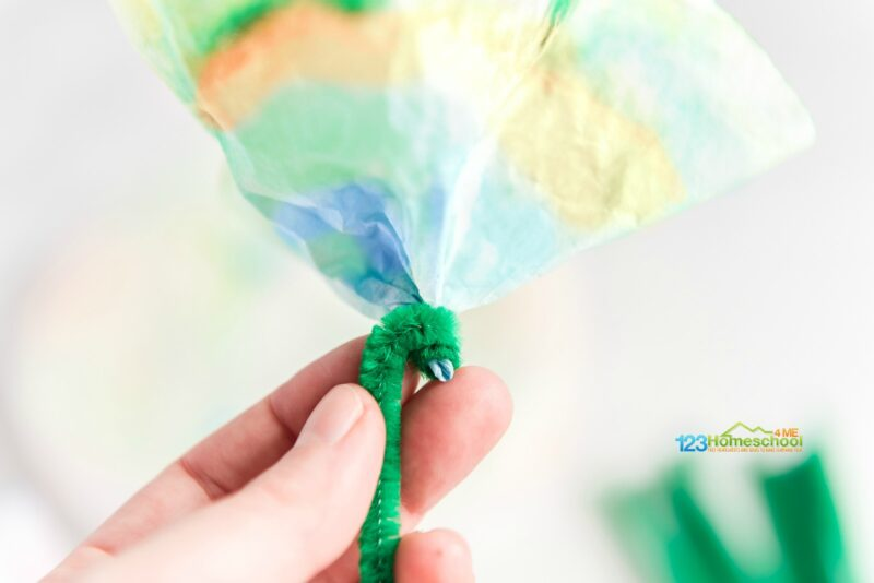 beautiful chromatography flower made from coffee filter, green chenille stick, water soluble ink markers, and STEAM