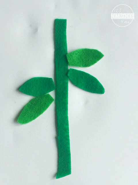 cut out felt stem and leaves and glue to cardstock just under recycled egg carton flower